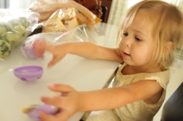 Sophie filling Easter Eggs