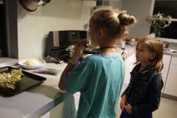 Girls sampling ricotta